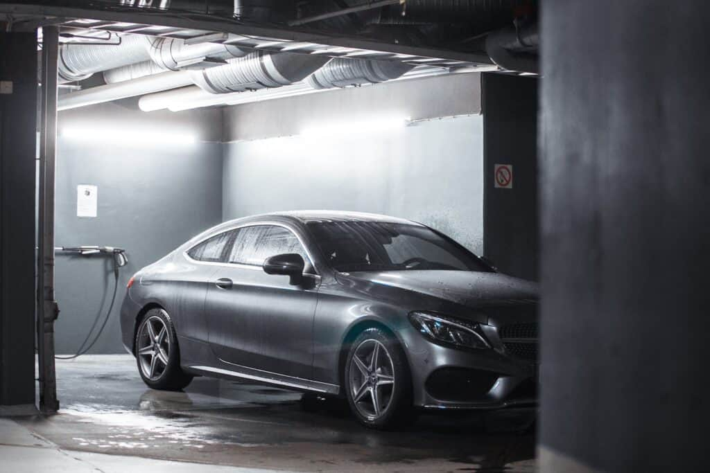 silver coupe inside building